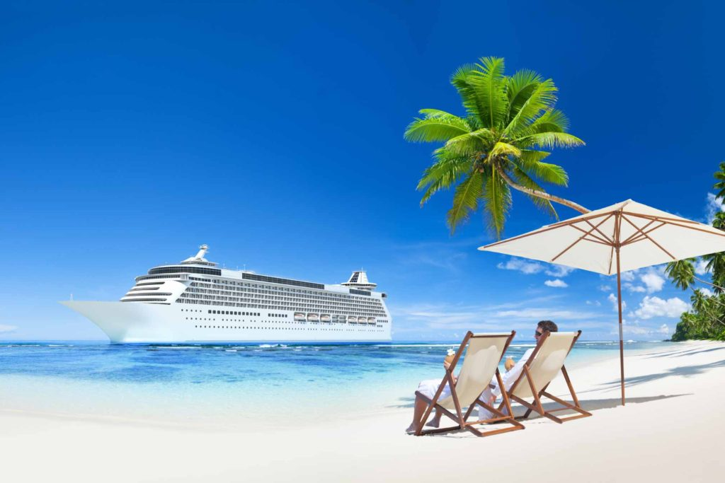 Image of sandy beach with cruise ship in distance