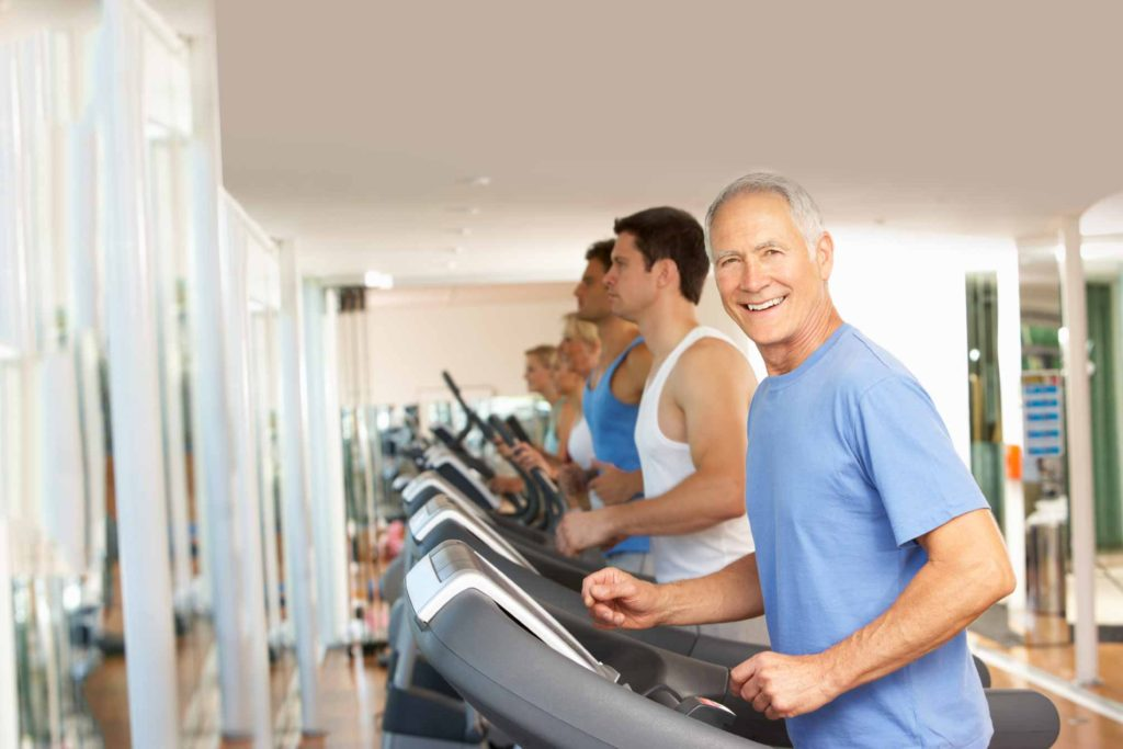 Photo of smiling man on treadmill